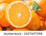 heap of ripe organic oranges at ...   Shutterstock . vector #1027697398