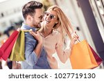 stylish young couple doing... | Shutterstock . vector #1027719130