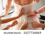wedding help. hands of... | Shutterstock . vector #1027736869
