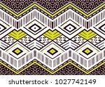 ikat geometric folklore... | Shutterstock .eps vector #1027742149