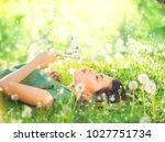 beautiful young woman lying on... | Shutterstock . vector #1027751734