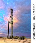 drilling rig at sunrise  with... | Shutterstock . vector #1027755214