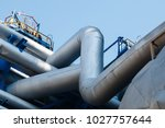 steel pipes at the plant for... | Shutterstock . vector #1027757644