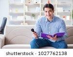 funny man singing songs in... | Shutterstock . vector #1027762138