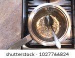 sugar syrup in a saucepan   Shutterstock . vector #1027766824