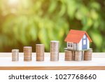 view of coin stack with house... | Shutterstock . vector #1027768660
