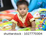 8 month old baby wearing a red... | Shutterstock . vector #1027770304