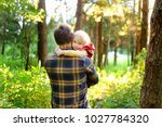 father and his little son... | Shutterstock . vector #1027784320