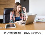 woman thinking about work on... | Shutterstock . vector #1027784908