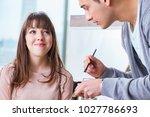 man doing make up for cute...   Shutterstock . vector #1027786693