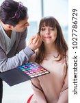 man doing make up for cute...   Shutterstock . vector #1027786729