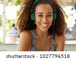 smiling stylish african... | Shutterstock . vector #1027796518
