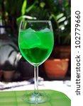Cold green soda in glass - stock photo