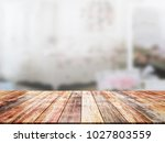 closeup top wood table with... | Shutterstock . vector #1027803559