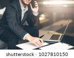 handsome businessman in suit... | Shutterstock . vector #1027810150