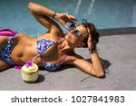 beautiful tanned young woman... | Shutterstock . vector #1027841983