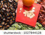 Small photo of Traditional lunar new year snack tray with red packet word mean luck