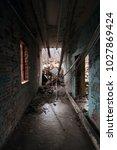 dark hallway in an abandoned...   Shutterstock . vector #1027869424