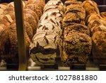 variety of wholegrain breads... | Shutterstock . vector #1027881880