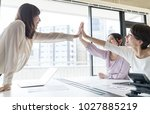group of woman giving high five. | Shutterstock . vector #1027885219