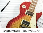 electric guitar with music... | Shutterstock . vector #1027920670