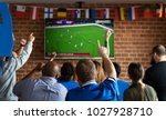 frieds cheering sport at bar... | Shutterstock . vector #1027928710