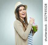 smiling woman holding detox... | Shutterstock . vector #1027935328