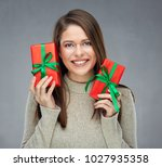 happy woman wearing gray... | Shutterstock . vector #1027935358