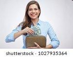 portrait of happy woman holding ... | Shutterstock . vector #1027935364