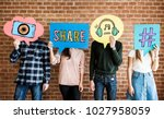 friends holding up thought... | Shutterstock . vector #1027958059