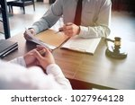 legal counsel presents to the... | Shutterstock . vector #1027964128