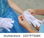 close up mother hands wearing... | Shutterstock . vector #1027975684