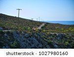 scenic road in greece with... | Shutterstock . vector #1027980160