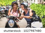happy couple of tourist... | Shutterstock . vector #1027987480