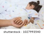 mother hand holding sick... | Shutterstock . vector #1027993540
