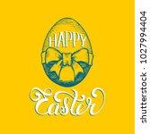 hand lettering happy easter in... | Shutterstock .eps vector #1027994404
