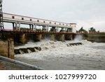 water rushing through gates at... | Shutterstock . vector #1027999720