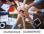 young people putting hands... | Shutterstock . vector #1028009050