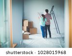 portrait of young couple moving ... | Shutterstock . vector #1028015968