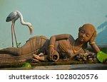 old woman and egret bird... | Shutterstock . vector #1028020576