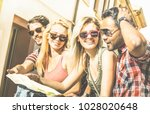 group of young hipster tourists ... | Shutterstock . vector #1028020648