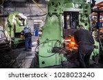 metal forging  forging shop.... | Shutterstock . vector #1028023240