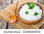 boiled rice in a wooden bowl... | Shutterstock . vector #1028030053