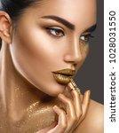 fashion art golden skin woman... | Shutterstock . vector #1028031550