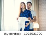 man and a pregnant young woman... | Shutterstock . vector #1028031700