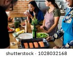 Small photo of Diverse people joining cooking class