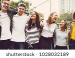 smiling happy young adult... | Shutterstock . vector #1028032189