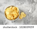 bowl with crispy potato chips... | Shutterstock . vector #1028039059