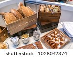 bread bar station in buffet line | Shutterstock . vector #1028042374