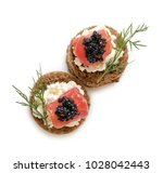 Small photo of Delicious canapes with black caviar on white background